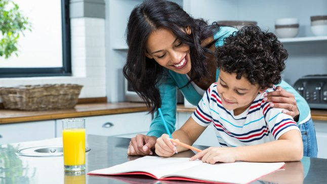Mother helping son do homework